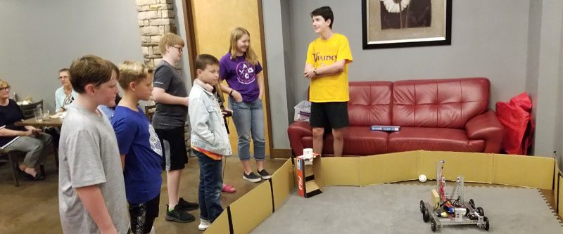 Local kids come to Trojan Grill to drive our robot and learn about robotics